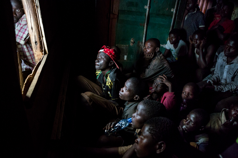 children watching tv in kampala