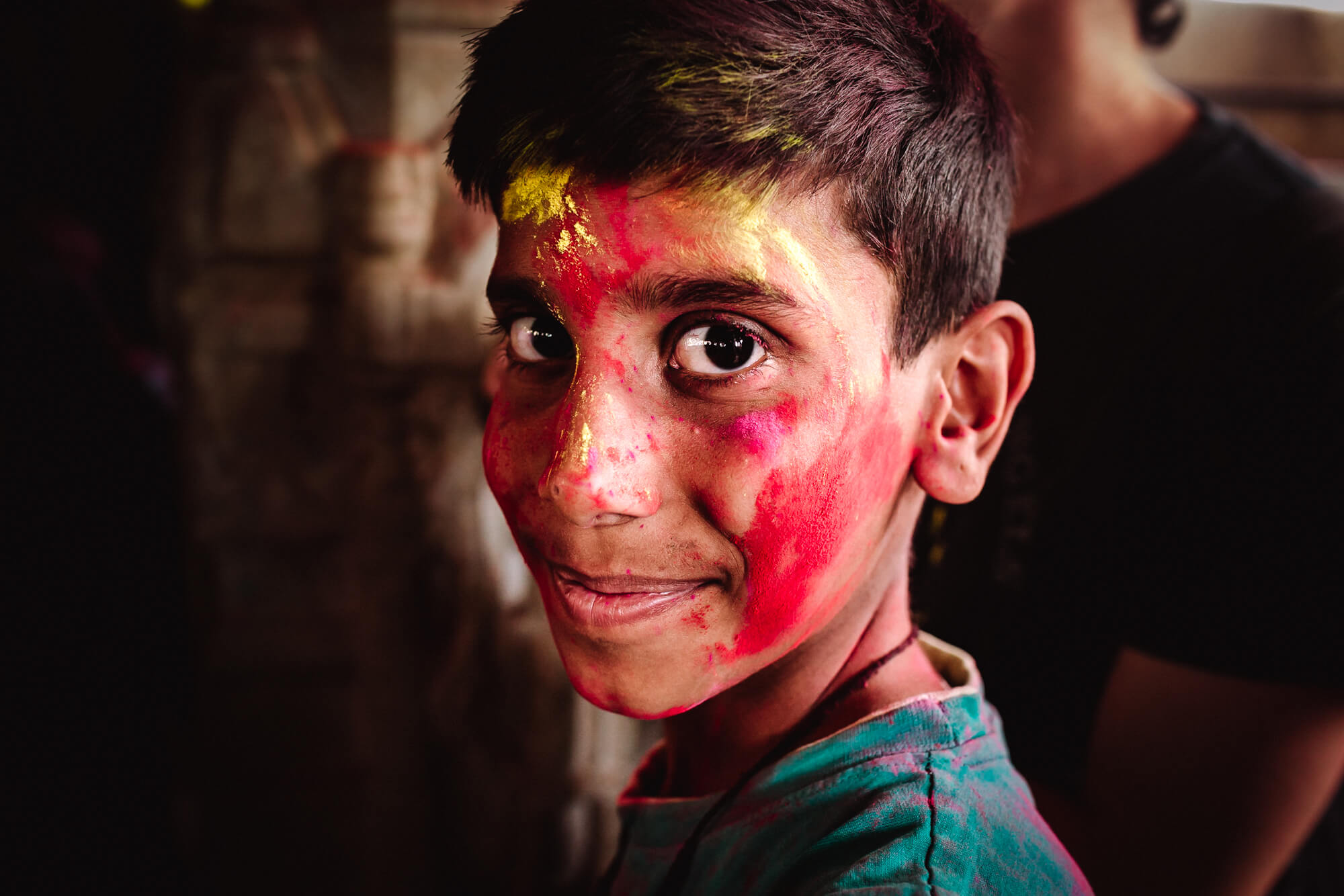 boy with the face full of colours