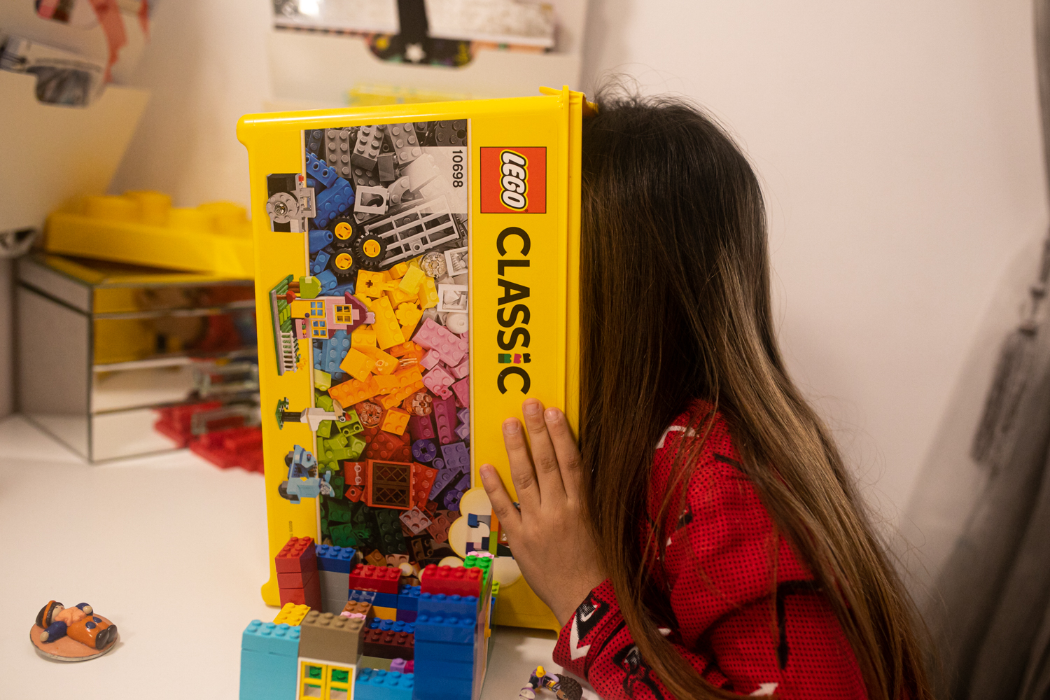a girl is playing lego in barcelona
