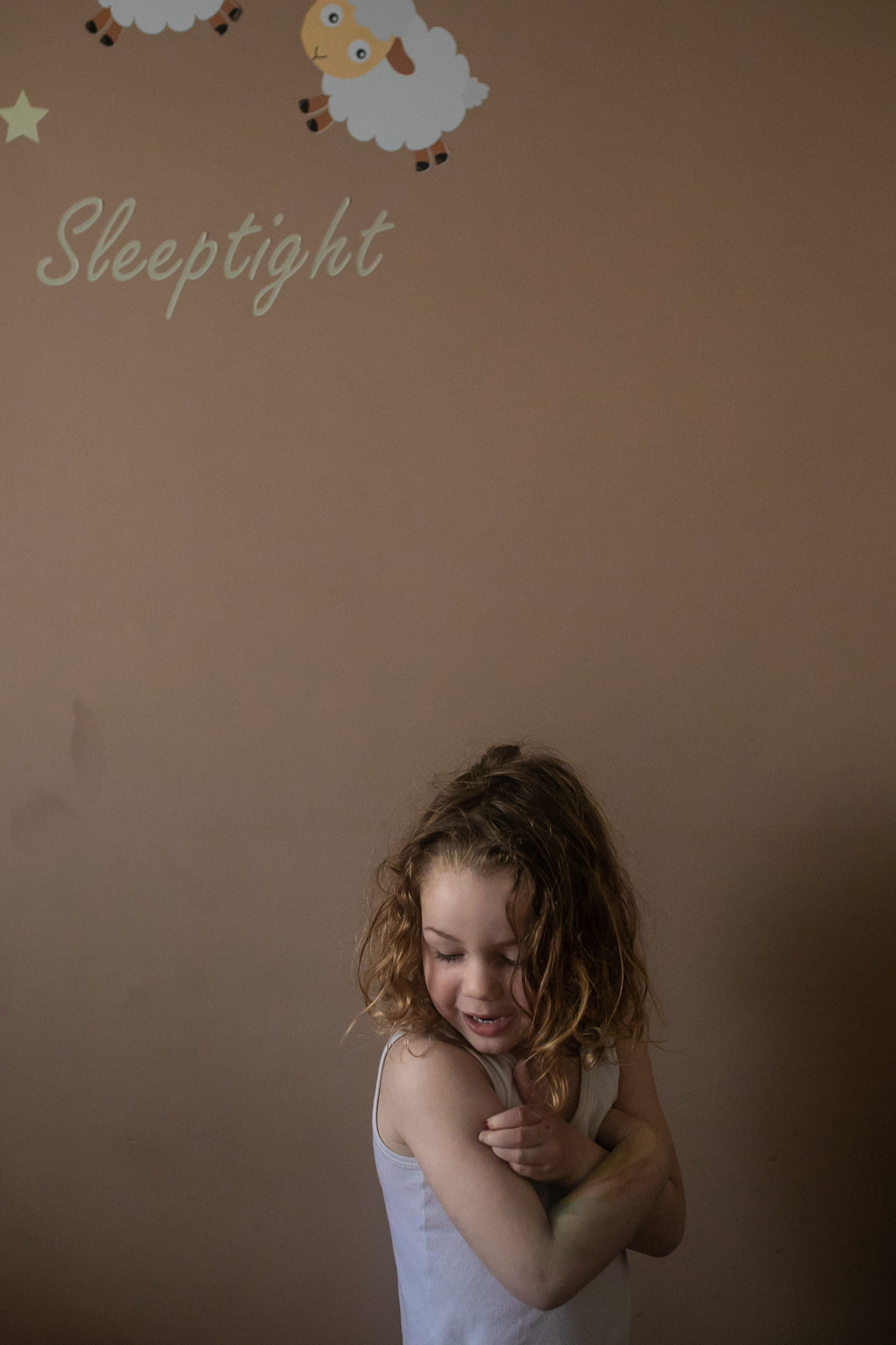 a small girl in her room